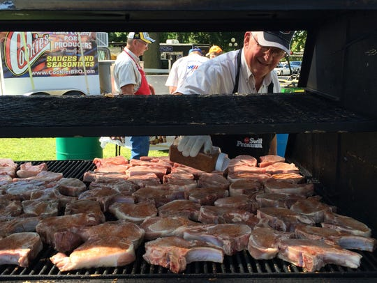 Keith Sash Works of Gladbrook, a member of the Tama County Pork Producers, cooks pork chops and ribs for visitors to the World Pork Expo in 2016 at the Iowa State Fairgrounds in Des Moines.