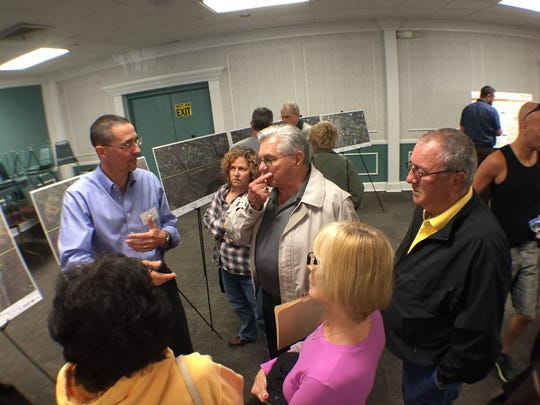 Residents talk with JCP&L consultant Kyle King, president of K&R Consulting, about the the utility's proposed transmission line on Wednesday evening.