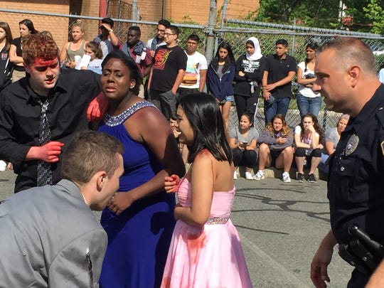 Students from the Morris County School of Technology in Denville, along with police and emergency responders, stage a dramatic recreation of a fatal car crash involving students on their way to a prom. June 8, 2016