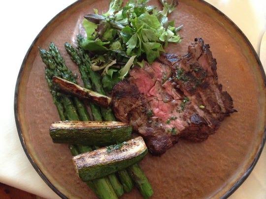 One health-conscious diner's choice turns a classic plate of steak frites into a meat-and-vegetable dinner of medium rare local steak and asparagus at Tourterelle restaurant in New Haven.