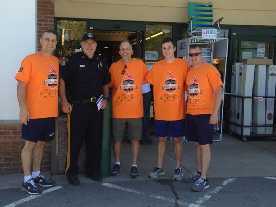 Awaiting the start of the Bernardsville leg of the New Jersey Law Enforcement Torch Run for Special Olympics are (L-R): Sgt. Jeff Melitski, Lt. John Gardner, Ed and Max Halper of Basking Ridge, and Officer Dan Butell. The team ran the length of Bernardsville enroute to the torch's final destination at the College of New Jersey in Ewing, the site of the 2016 N.J. Special Olympics. The picture was taken outside the Shop Rite on Rt. 202. Shop Rite is a major corporate sponsor of the event, held June 11th.