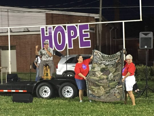 Various items, including this Cades Cove wall-hanging were auctioned off during the Houston County Relay for Life on June 10.