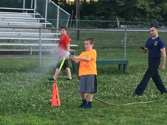 A young firefighter begins an obstacle course set up by the Erin Fire Department.