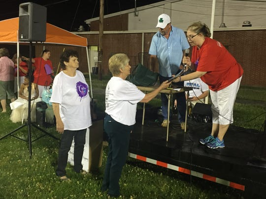 Cedar Valley Church members receive a plaque from Relay for Life Chairwoman Teresa Myer. The church raised the most money for the 2015 Relay.