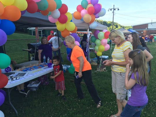 People check out Houston County Community Hospital's camp site at Houston County Relay for Life. The team received the Most Spirit award.