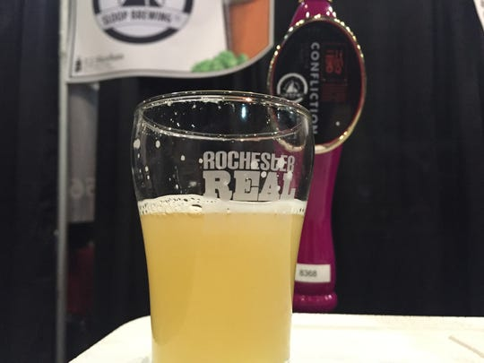 A pour of Sloop Confliction at Saturday's Rochester Real Beer Expo at the Blue Cross Arena.