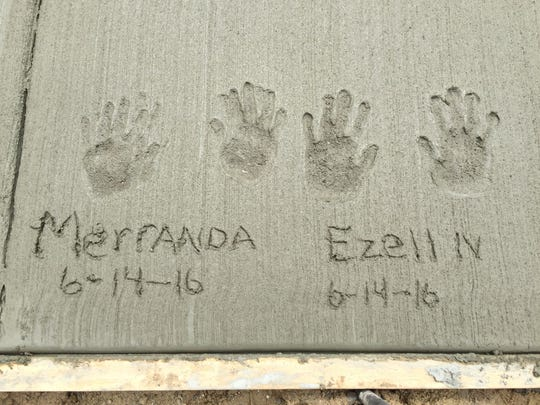 The hand prints of Merranda Robinson, 7, and her brother