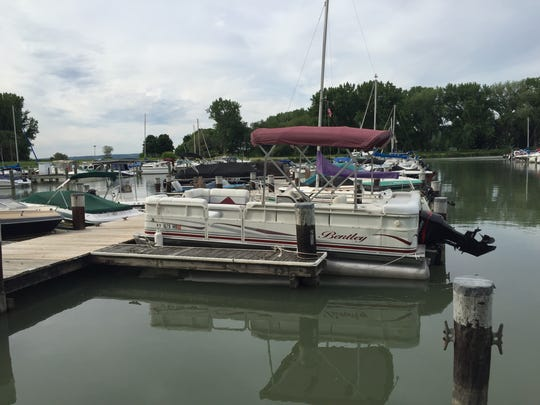A pontoon boat parked on the docks at Allan H. Treman State Marine Park in Ithaca.