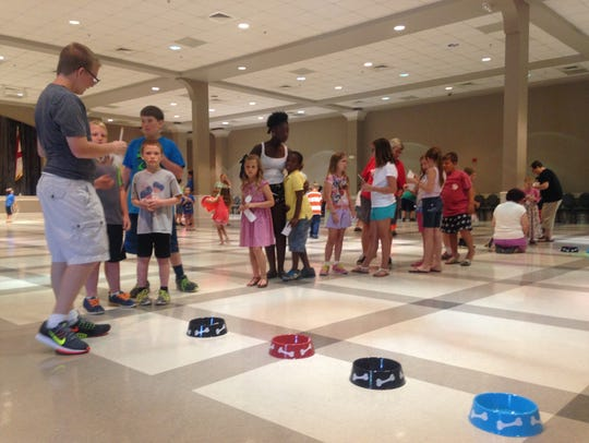 Children play Olympic-style games Tuesday to kick off