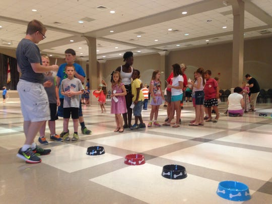 Children play Olympic-style games Tuesday to kick off the Wetumpka Public Library's Summer Reading Program.