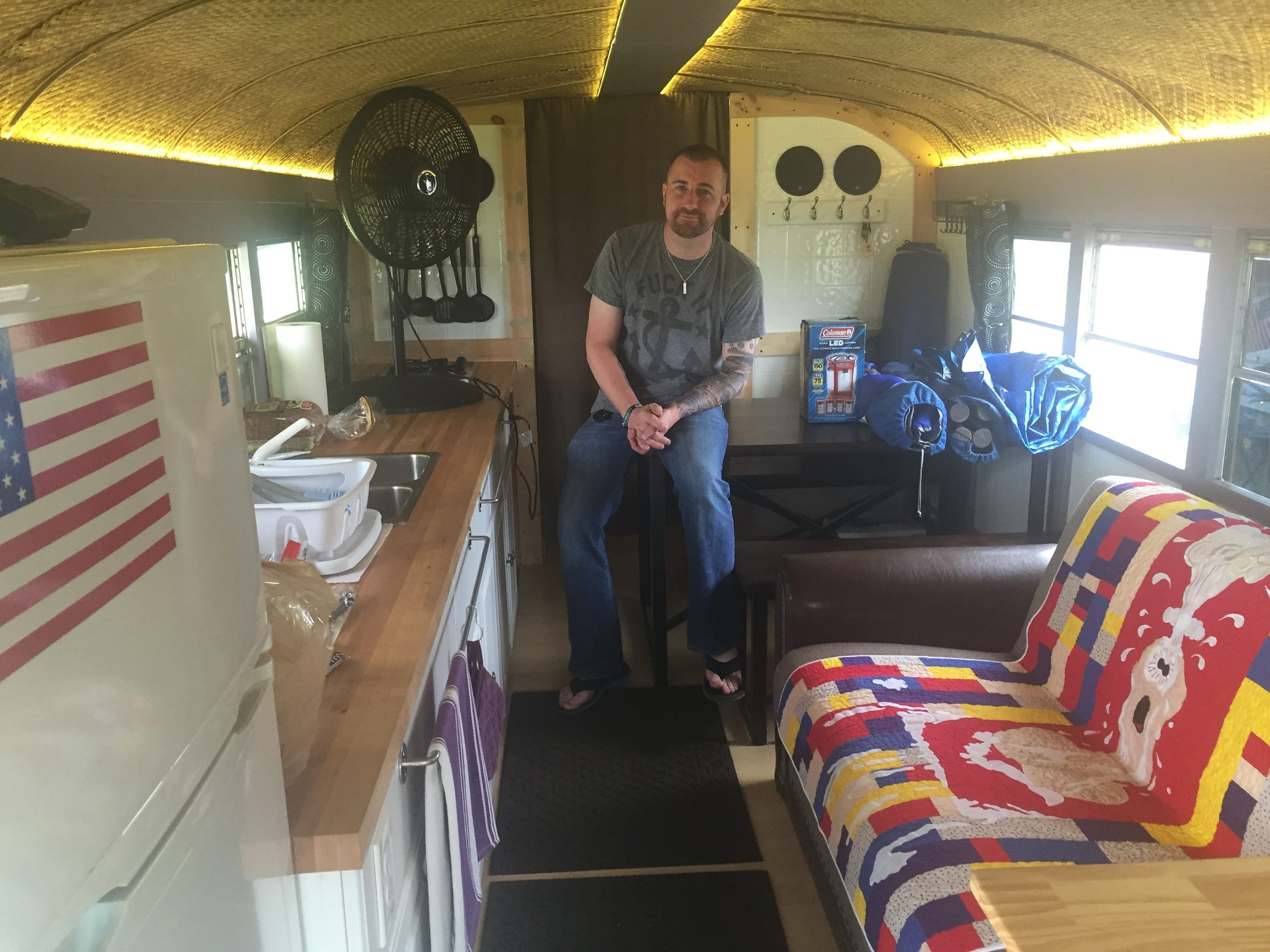Joel Foushee spent $15,000 decking out a school bus and turning it into a Firefly campmobile.