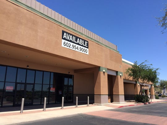 A long-time vacant store building at Elliot Road and Priest Drive in Tempe, Arizona that used to a Sports Authority.