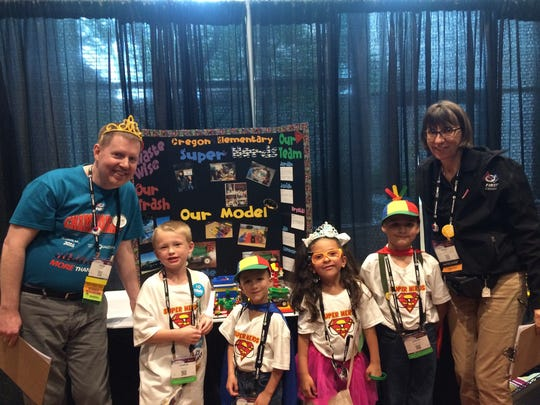 The Super Nerds from Oregon Elementary School with their judges at the competition. From left to right: Connor Snyder, Jax Dodson, Krystal Mendez and Jordan Dodson.