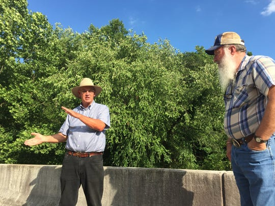 Neighbors Durant Ashmore, left, and Donnie Tollison, right, talk about the Colonial Pipeline spill 20 years after they witnessed it.