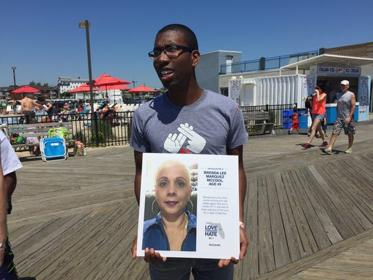 Kelly Bethea, 26, of Asbury Park, holds a picture of