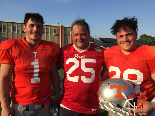 Keyport fullback Andy Laguna (center) flanked by his