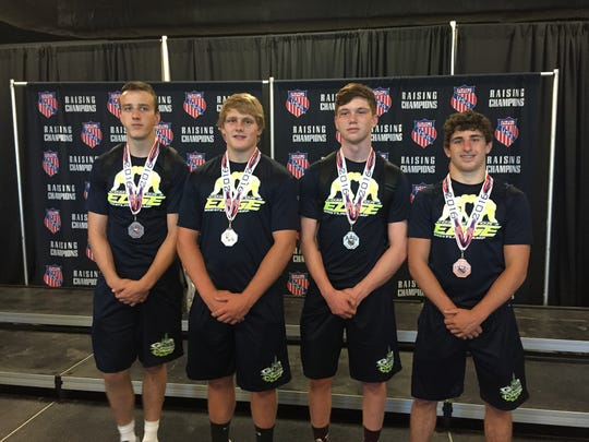 Xavier Beach, Matt Herrick, James Limongi and Damian D'Emilio, left to right, earned medalist honors at the AAU Scholastic Duals wrestling tournament.