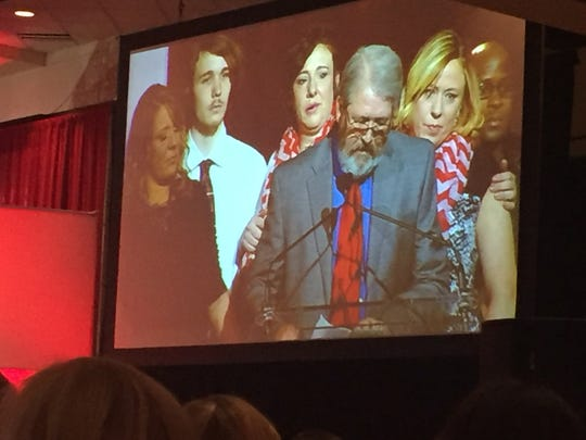 Surrounded by family, Murray Gipe speaks about his late wife, Laura, at the Louisville Go Red for Women Luncheon in May 2016.