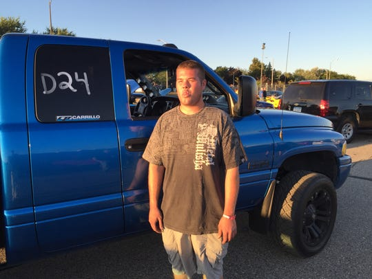 "Tyler Teague with his 2001 Dodge Ram 2500 at ""Roadkill"