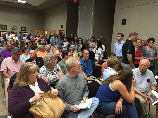 People attend a meeting in Middletown to oppose a proposed JCP&L power line.