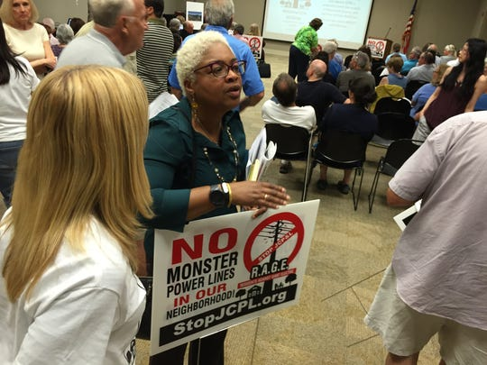 People opposing JCP&L's proposed power line from Aberdeen to Red Bank attend a meeting in Middletown.