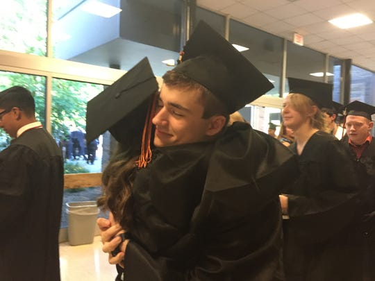 Cristina Orgoch, 18, of Holmes, and Ryan Kendra, 18, of Pawling, hug as the class of 2016 at Pawling High School lines up for graduation Friday.