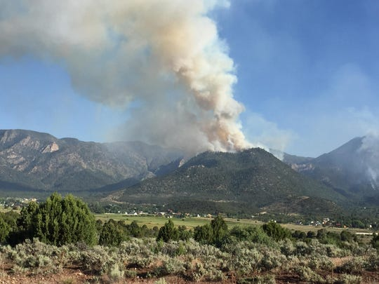 The Saddle Fire burns along the mountains just south