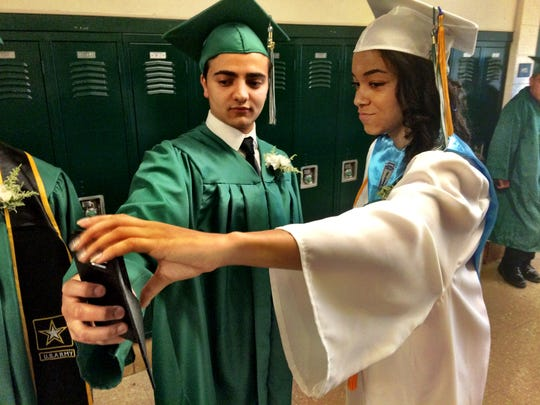Mohamed Zenaty, 18, of Wassaic, and Kenya Blue, 18, of Millerton take a selfie before graduating from the Webutuck Central School District Saturday.