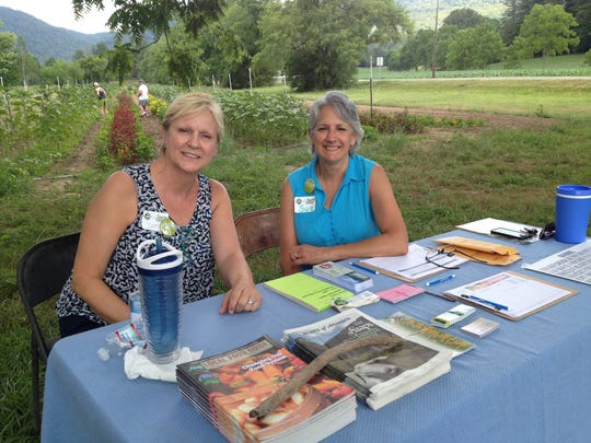 At Flying Cloud Farm, ASAP volunteers Deborah Redmond and Sue Korrow greeted visitors on the 2016 Farm Tour.