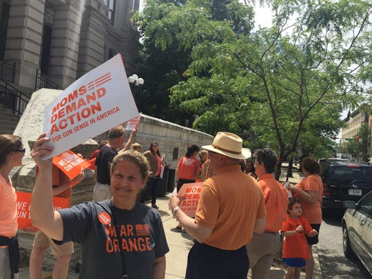 Members of the local chapter of Moms Demand Action for Gun Sense begin a march through downtown June 2 at the Tippecanoe County Courthouse.