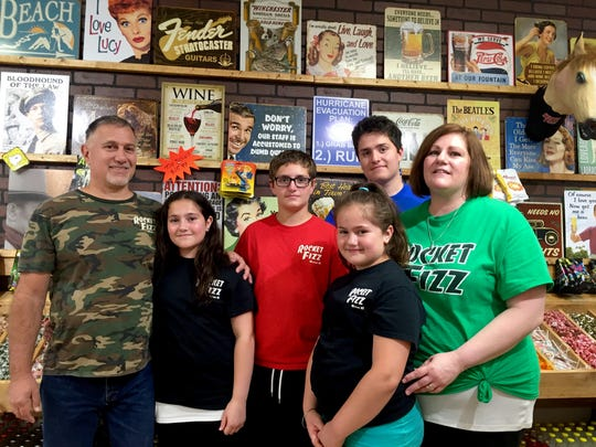 Andrew and Joann Ammazzaorsi with their children Emily, Nick, Olivia and Andrew in Rocket Fizz.