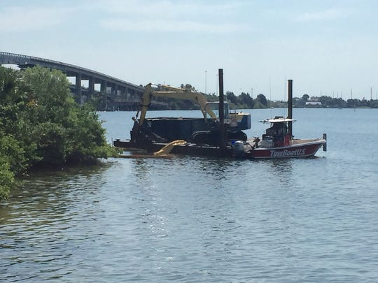 Crews remove derelict boats from the Indian River Lagoon