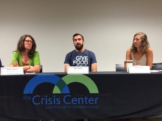 Johnson County Local Food Specialist Shanti Sellz, Coralville Food Pantry Director John Boller and Iowa City Farmers Market Manager Cassidy Bell speak at a panel on healthy foods at the Johnson County Hunger Forum on Tuesday.