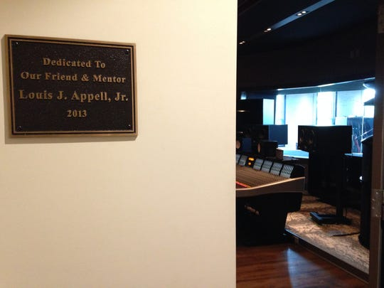 A plaque at the entrance to one of the studios at 210 York St., York, pays homage to Louis Appell Jr. Members of the band Live dedicated the studio to Appell several years ago. Appell, a philanthropic and influential businessman from York, died Monday. He was 92.