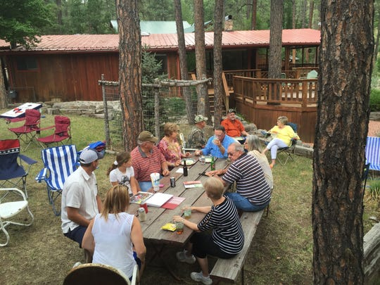 Part of the Halbert family reunion gathered at the old cabin of Ida and Lloyd Bloodworth for a hot dog lunch in Ruidoso.