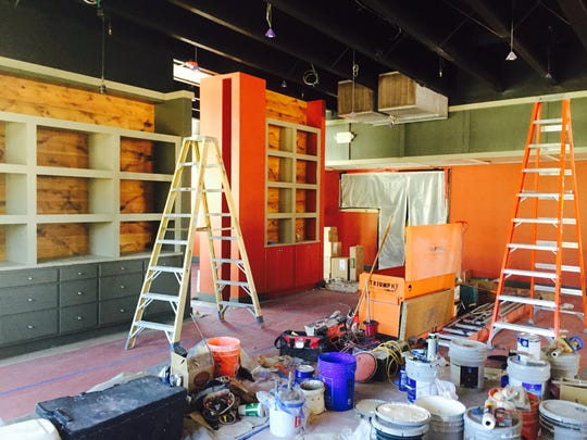 The main dining room of the new Campo Sparks has burnt orange walls.