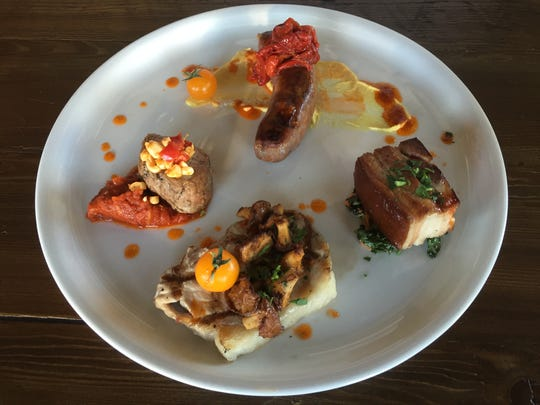 Butchering is done in house at the new Campo in Sparks. This platter offers pork four ways.