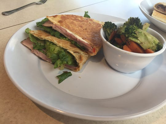 Rosemary ham and mozzarella piadina with roasted vegetables at Zoës Kitchen, 311 S. College Ave. Suite 130, which offers fresh Mediterranean cuisine.