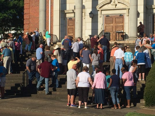 People gathered on the steps of First Baptist Church in Lousiville Wednesday night to pray for Chanda Smith's safe return.