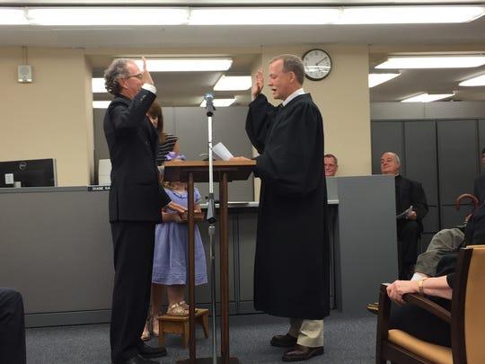 Mike Spence, left, was sworn in as Caddo Parish Clerk