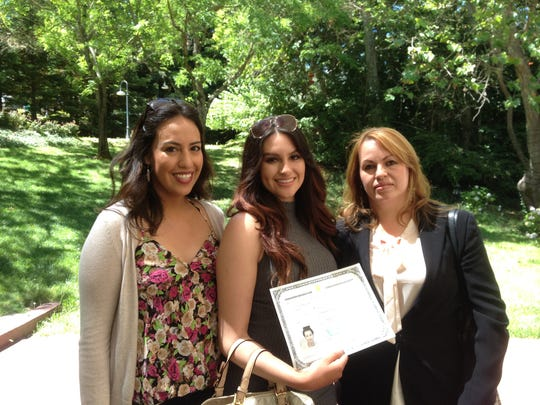 Ms. Duran Proa, center, became a US citizen Thursday with her mother Gloria, right; and her cousin in attendance.