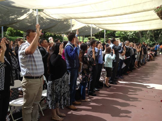 New Americans take oath of citizenship Thursday at Gilroy Gardens.