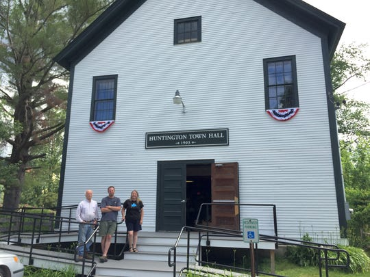 Huntington residents Terry Boyle, from left, Aaron Worthley and Linda Fickbohm are working to restore the historic town hall, built in 1903, to become a year-round community event space.