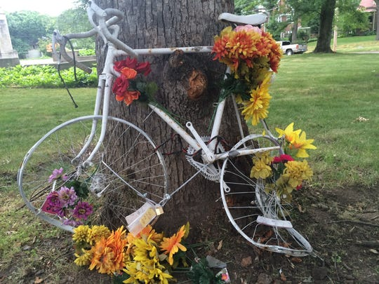 """The """"ghost bike"""" for Gregary """"Wade"""" Franck stands at the corner of 51st Street and Grand Avenue after it was struck by a car Friday, July 1, 2016."""
