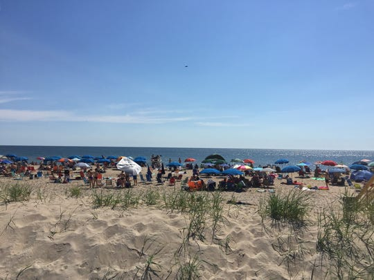 Crowds gather on the beach just off the Bethany Beach Board Walk to enjoy the July 4 weekend