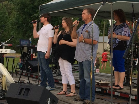 The Lovelace Family quartet sings gospel songs Sunday at the 6th annual Picnic in the Park in Ramer, Tennessee.