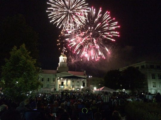 Fireworks burst behind the Old Capitol in downtown