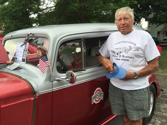 Bob Matecki, of Port Clinton, shows off a 1934 Oldsmobile valued between $20,000 and $50,000.