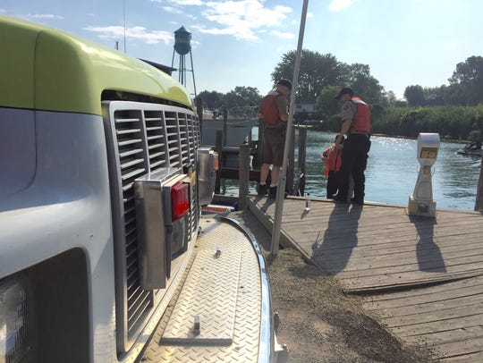 Dive team members prepare to search for a missing swimmer