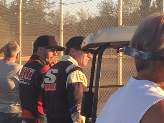 Matt Crafton (left) and Tony Toste watch a race at